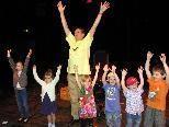Begeisterte Kinder beim Sing-Workshop