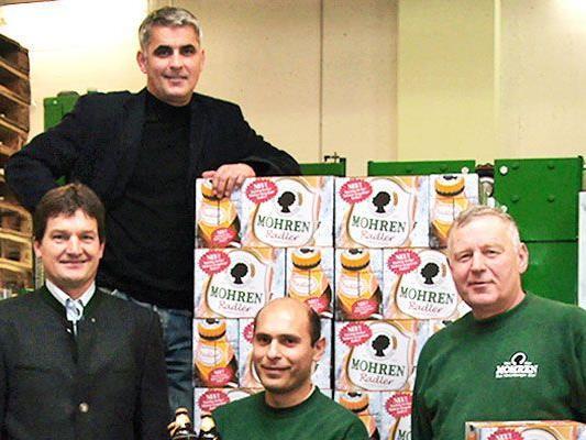 Heinz Huber, Markus Hämmerle, Zoran Stanculovic und Wilfried Frick präsentieren stolz ihr Produkt.