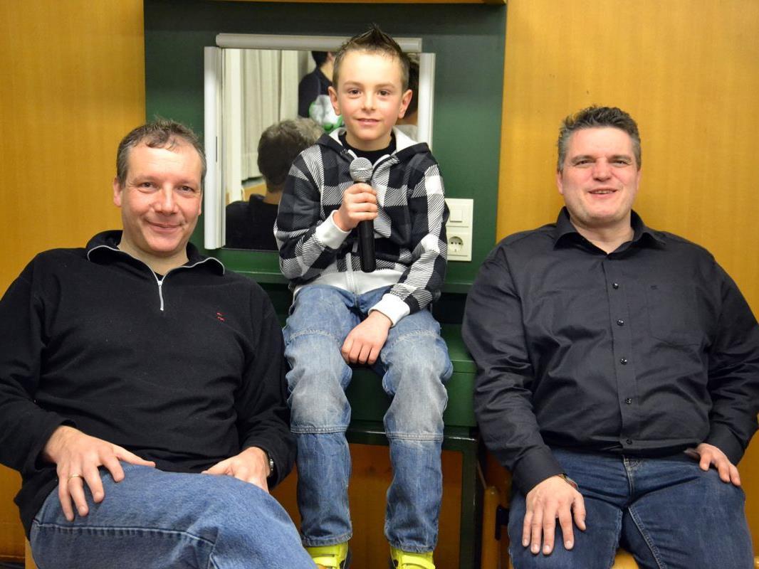 Stefan und George mit Fan Linus in der Mitte.
