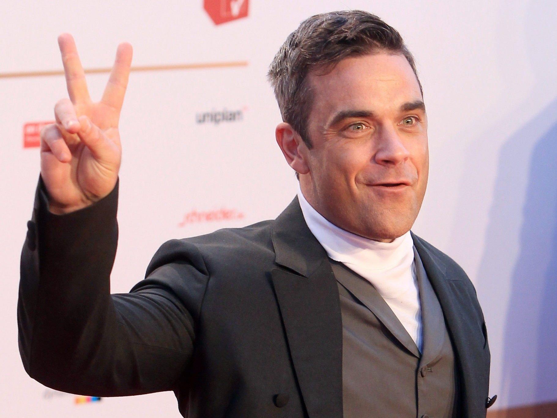 """Robbie Williams hat den Song """"Candy"""" zusammen mit Gary Barlow produziert."""