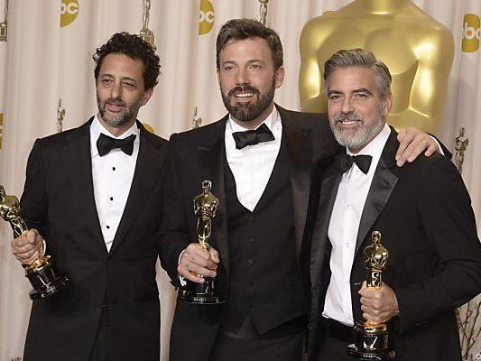 Grant Heslow (l.), Ben Affleck und George Clooney