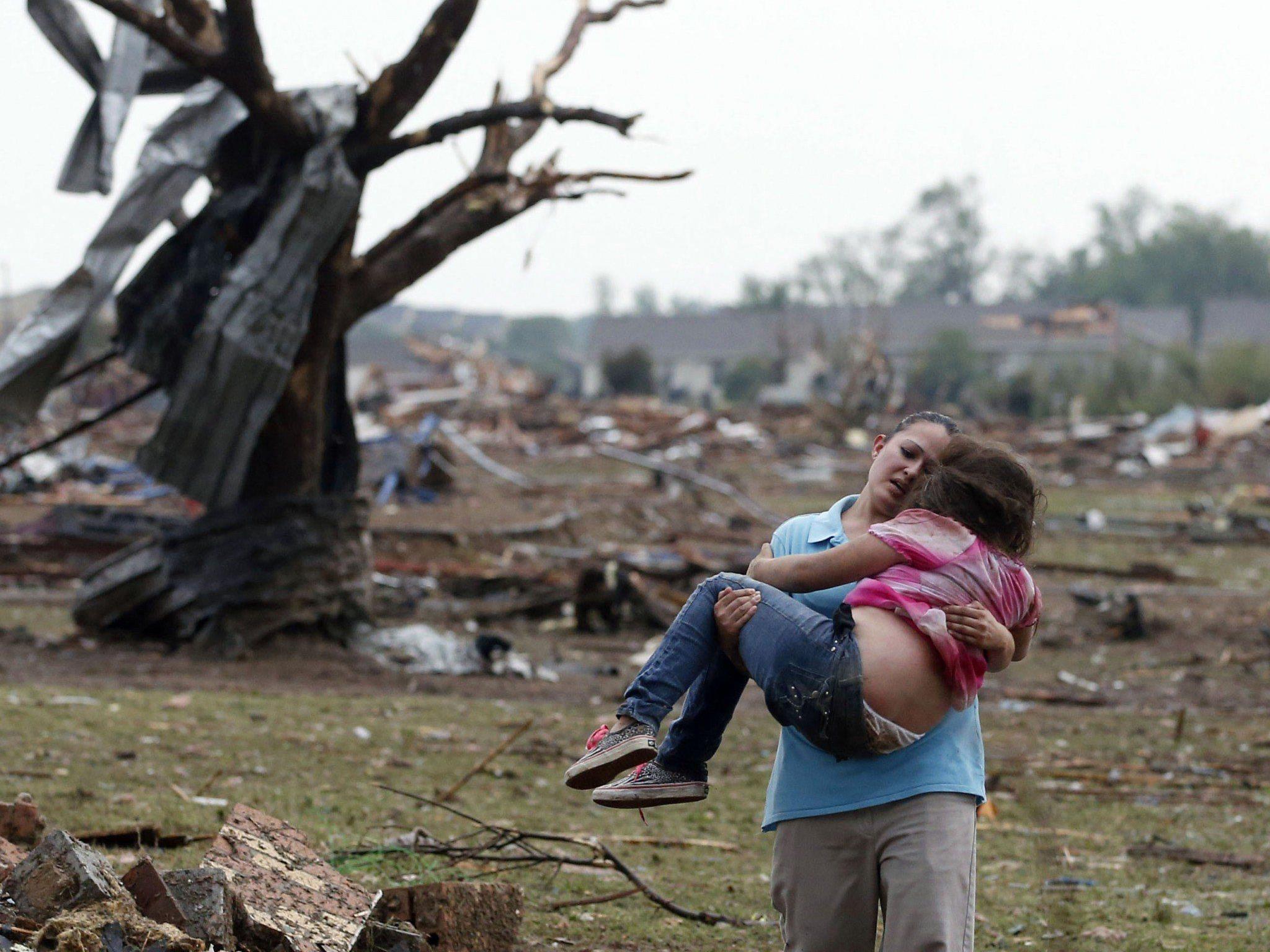Weitere Leichen unter Trümmern einer Volksschule befürchtet - Obama sagte Hilfe zu.