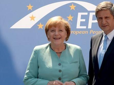 Michael Spindelegger mit der deutschen Bundeskanzlerin Angela Merkel.