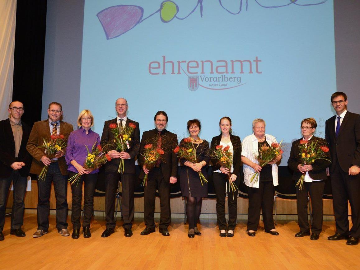 Traditionelle Auszeichnung am Nationalfeiertag von Caritas Ehrenamtlichen.