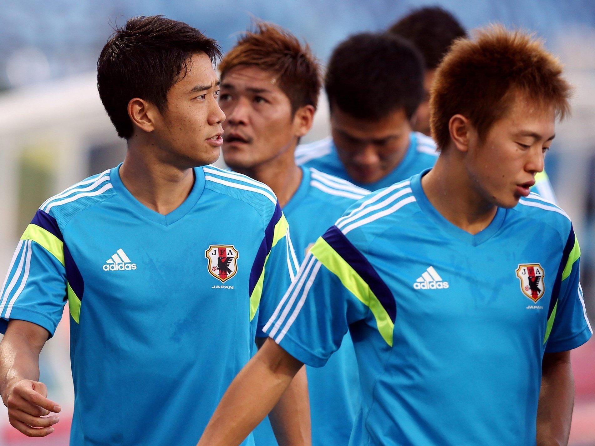 Für Japan und Shinji Kagawa (l.) stehen die Chancen auf das WM-Achtelfinale nicht gut.