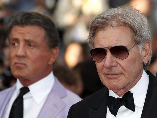 Schauspieler Harrison Ford (rechts) mit Sylvester Stallone bei den Filmfestspielen in Cannes.