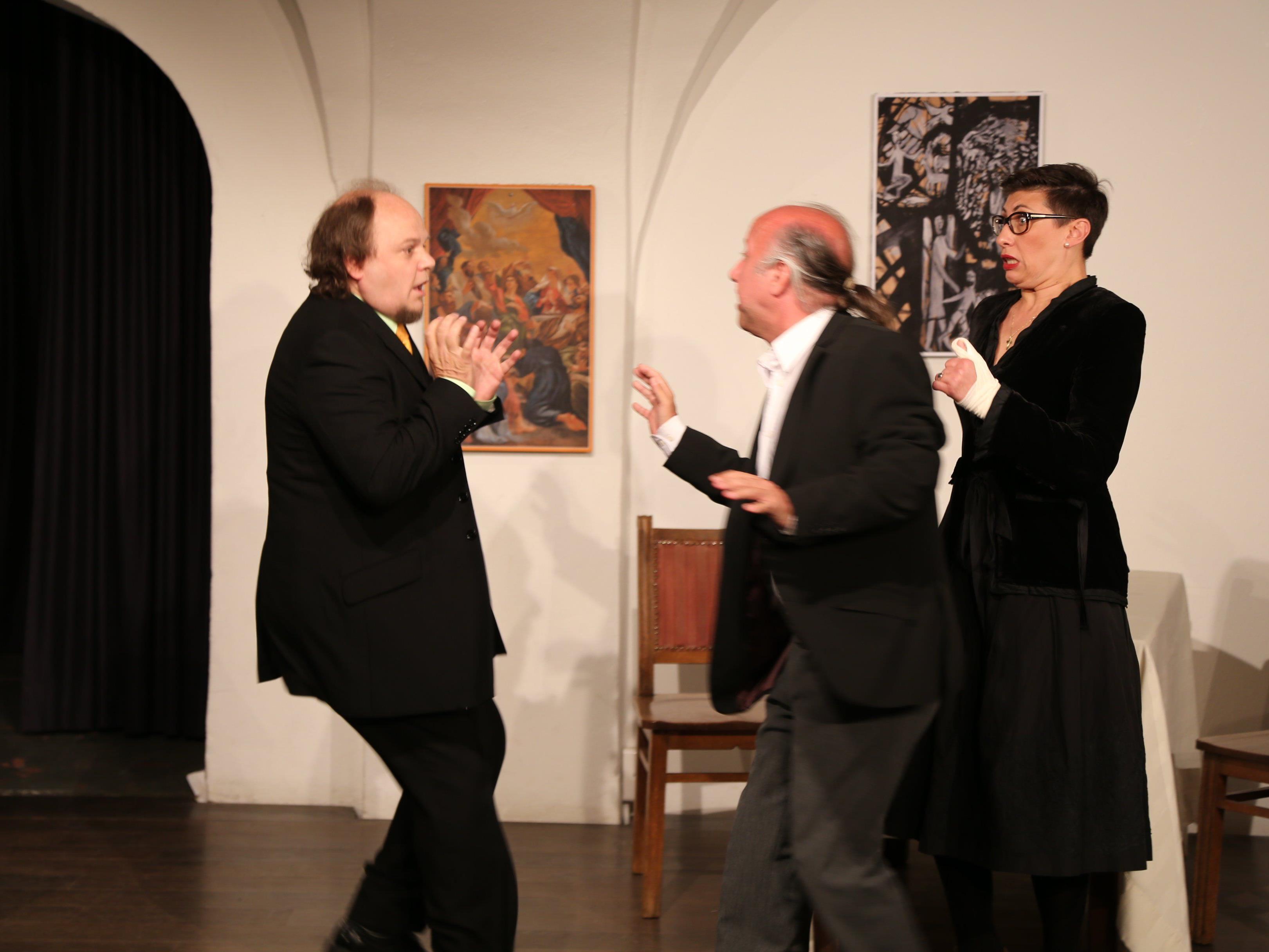 Szene mit Tartuffe (Wolfgang Rainer, links), Marcus Harm, Alexandra Lässer.