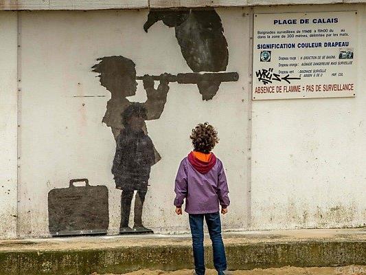 Banksy kritisiert mit seinen Bildern auch den Umgang mit Flüchtlingen