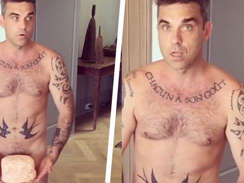 Robbie Williams serviert Torte im Adamskostüm.