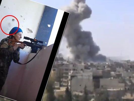 Kurden-Kämpferin wird in Raqqa nur knapp von einer Kugel verfeht.